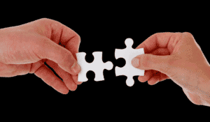 two puzzle pieces almost together