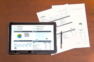 graph on ipad and report documents on a table