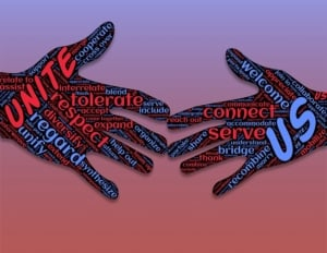 Annimated hands coming together with positive words on them like unite, tolerate