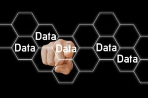 Finger pointing to word Data