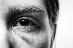 Man with tear coming out of his eye