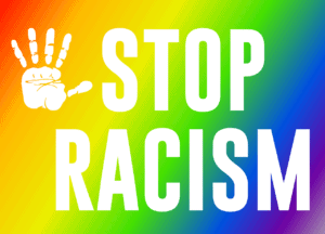Rainbow colored background with hand print and words stop racism