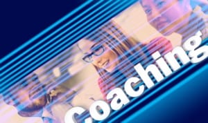 Young lady and word Coaching